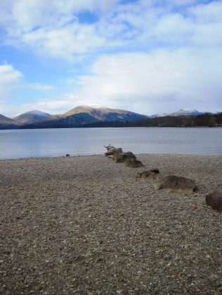 rocks, loch and mountains